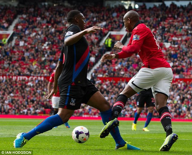 Ashley Young goes down after a challenge from Kagisho Dikgacoi