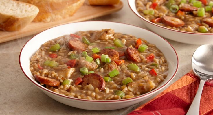 """A Louisiana favorite gumbo recipe, Chicken and Sausage Gumbo gets its flavor from the """"holy trinity"""" of Cajun cuisine – green onions, celery and bell peppers. Start with Zatarain's Gumbo Mix with Rice and add chicken and the sausage of your choice."""