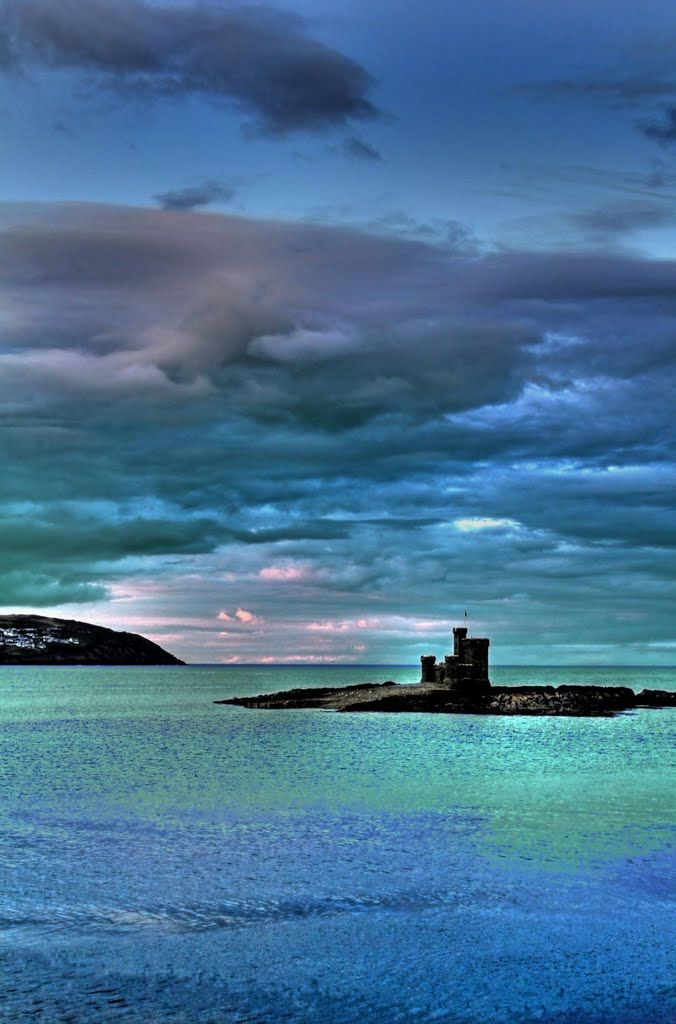 Tower of Refuge, Connister Rock , Douglas Bay, Isle of Man, UK The Refuge is a castle like structure built in 1832 as a safe place for stranded sailors in the dangerous waters of the Irish Sea