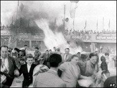 June 11, 1955 Lemans disaster. Spectators flee as the Mercedes-Benz exploded as it hit the grandstand. Parts of the wreckage were blown into the enclosure killing at least 80 people. The driver, Pierre Levegh, was killed outright. This was the biggest disaster at a motor racing circuit up to that time. Mercedes-Benz withdrew from all motor racing at the end of the 1955 season and didn't return until 1987.