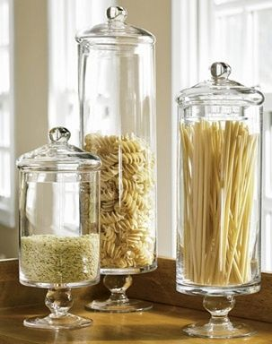 Purchase a few clear apothecary jars. You can find them in a multitude of shapes and sizes. Place them on your countertop to store frequently used food items like cereals, rice, pasta, and coffee. The effect is quite unique.