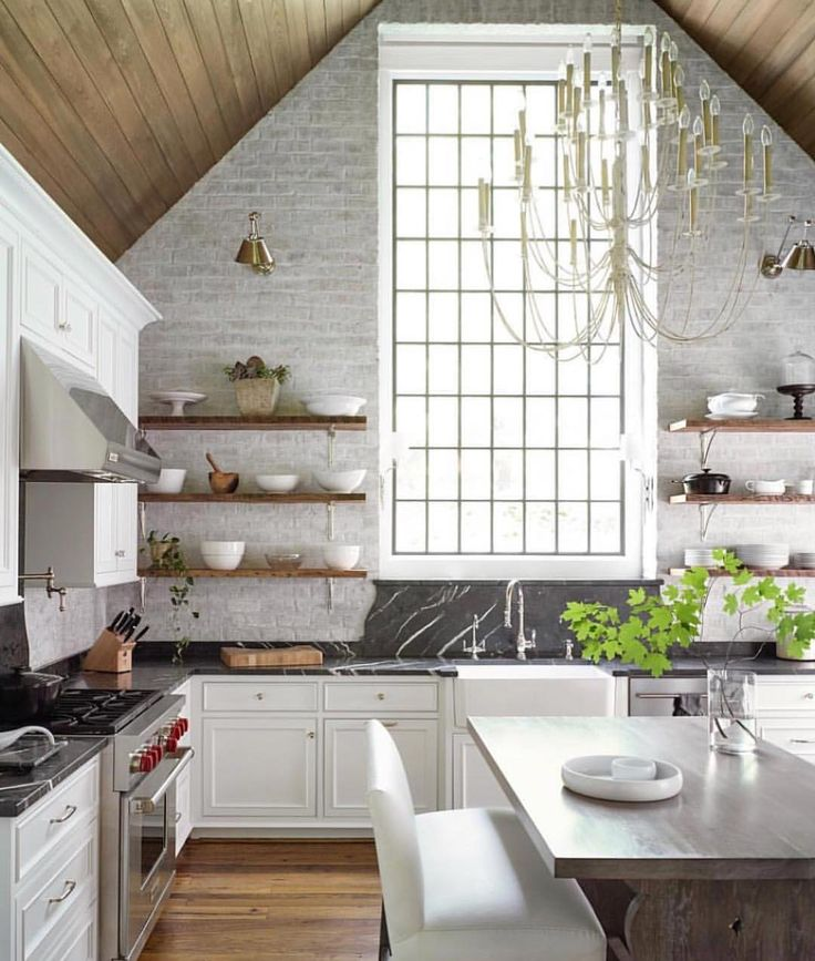 Kitchen with open shelving wood vaulted ceiling