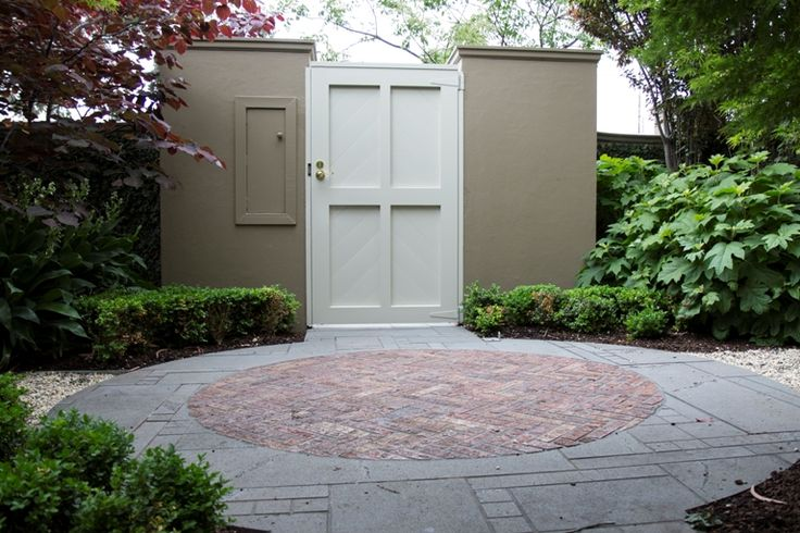 Bluestone and brick paving, designed by Vivid Design, constructed and maintained by Semken Landscaping