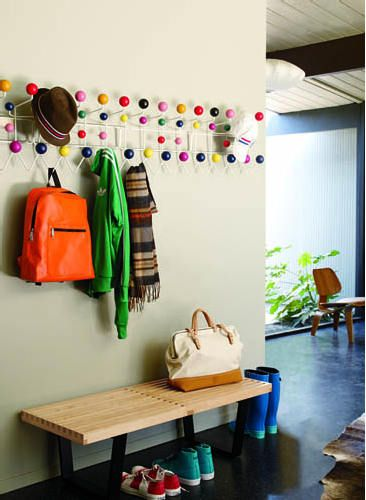 I know these eames hang-it-all coatracks are kind of ubiquitous, but i have to admit i love the cheerful pops of color it adds to this entryway