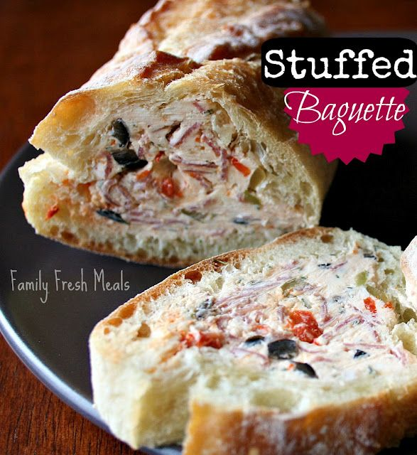 Stuffed Baguette! Here is what you need: Makes about 24 slices -baguette about 14 inches long (the one pictured is double that) - 8oz of cream cheese brought to room temp - 4 oz goat cheese - 1/4 cup each of green olives & black olives - 2 cloves minced garlic - 2 tbsp of chopped fire roasted peppers - 1 tsp dried parsley (if you have fresh, do 1 TBSP) * remember, if you are not a fan of any of the above ingredients for the filling, substitute with things you like :)