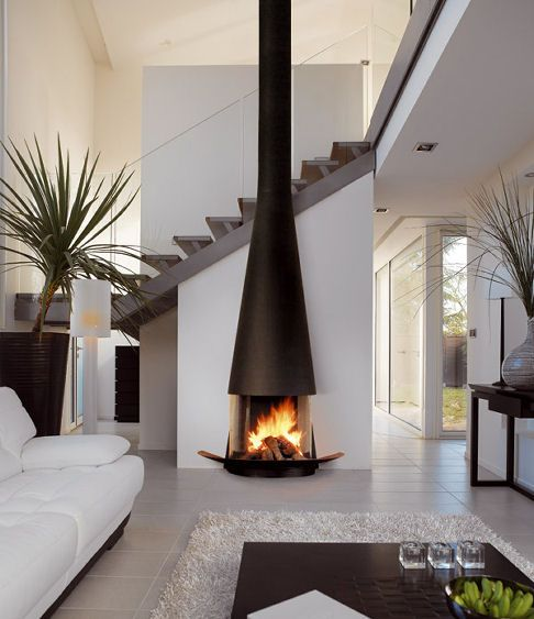 Fireplace that is located in the middle of the house interior and elegant…