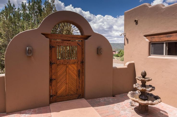 Southwestern Landscape/Yard with Justice Design Group Sun Dagger 1 Light Outdoor Wall Sconce, Fountain, exterior brick floors