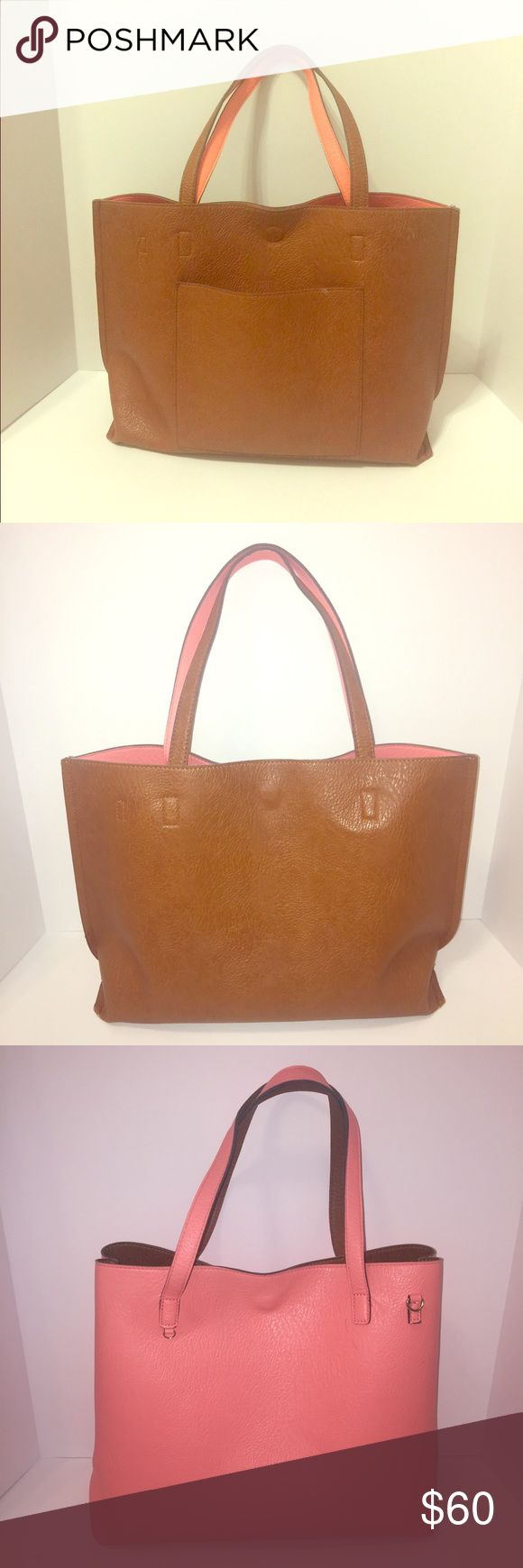 Urban Outfitters vegan leather reversible tote bag Beautiful and spacious tote bag reversible for both a brown and a peach/coral look! Comes with a detachable crossbody strap and pouch. Urban Outfitters Bags Totes