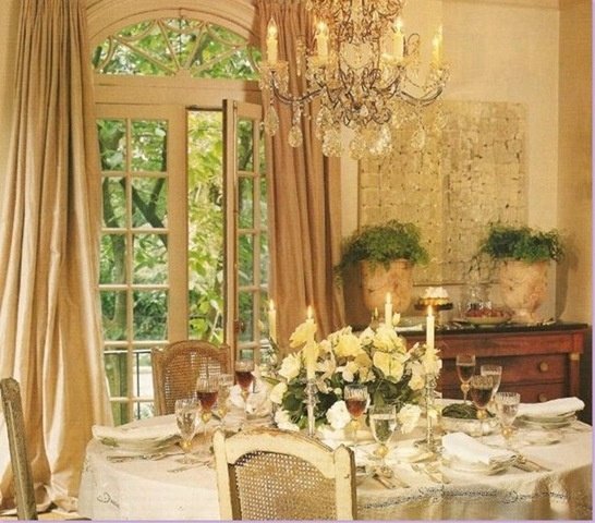 Beautiful, graceful dining room.  Look at that green view out the French doors  -  wonderful.  I can imagine having a nice supper party in this room  (with fancy food I had some caterers do. )