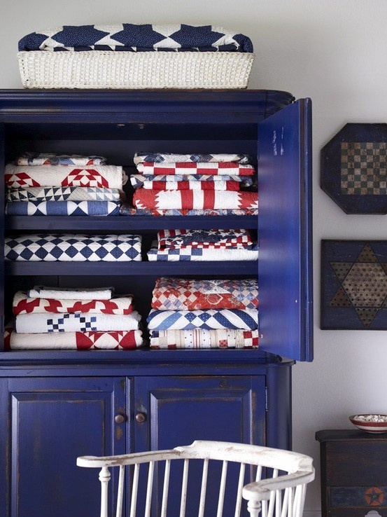 Love the blue cabinet....love the contrast between quilts and furniture.