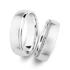 Trauringe Herrenring: Weißgold, Breite 6,5 mm Trauringe Damenring: Weißgold, Breite 6,5 mm, 21 Brillanten 0,13 ct. www.marrying.at