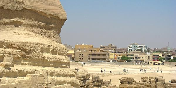 The Pyramids at Giza feature a backdrop of a Pizza Hut, a KFC, and a load of litter  Located not far from downtown Cairo, also be prepared t...