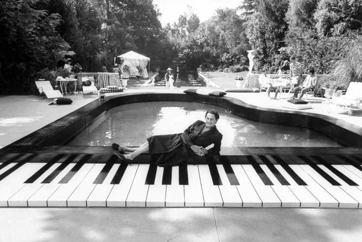 Liberace Behind The Music Lounging In Front Of A Piano Shaped Pool Wearing Robe Slippers