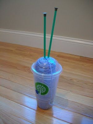 An interesting way to keep yarn stable while you knit on the go: use an old coffee cup!