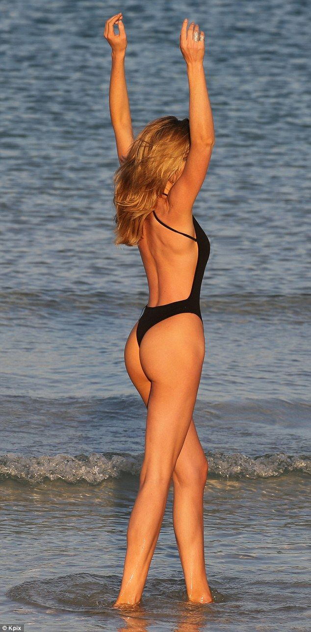 Abbey Clancy displays her stunning figure during beach photoshoot in Dubai | Daily Mail Online