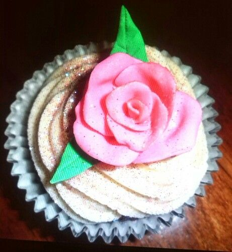 Fondant rose cupcake with buttercream swirl and lots of glitter made by Me