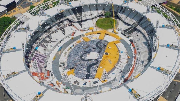 Olympic Stadium - the set for opening ceremonies is being built! That dark squiggle will represent the river Thames