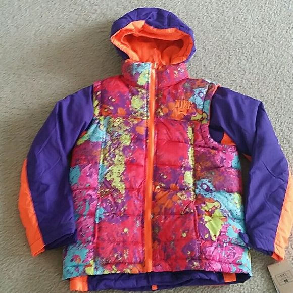 Girls Nike winter jacket coat sz medium NWT New with tag.  Nike winter jacket with detachable vest.   Vest can be worn on inside or outside of jacket and is reversible.  Vest can be zipped in if worn under outer jacket.  Girls size medium,  10 - 12 yrs, 140 - 152 cm.   Please check my other listings. Thank you for looking and have a great day! Nike Jackets & Coats Puffers