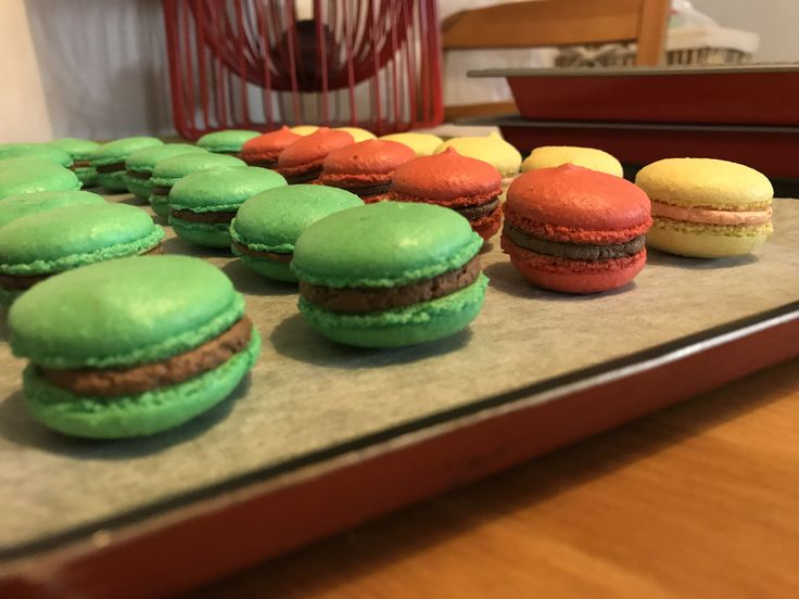 Macarons with chocolate and orange filling      Macaron   1 egg white 20gr sugar 50gr almond flower 65gr granulated sugar Food color    Fill:  100gr butter 150gr granulated sugar Vanilla extract Chocolate & orange icing powder