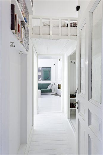 interesting use of space...just tuck a bed above a ceiling drop...very cool...