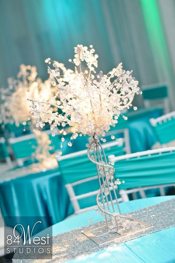 Sweet 16 centerpieces using crystal trees in tiffany blue, white, and silver