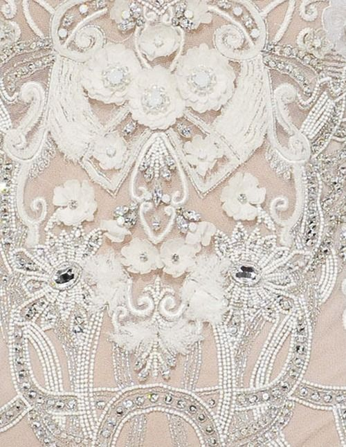 A true piece of Haute Couture Embroidery! Sequins, beads, rhinestones, 3D effects, etc. BEAUTIFUL!!!
