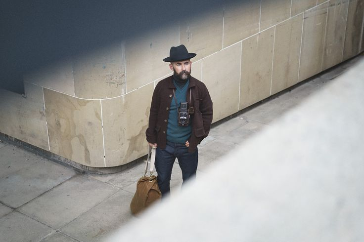 The Modern Gentleman - Tom wears the Eric jumper with the Hannibal cardigan and no.11 selvedge jeans. Topped off with a fur felt hat in navy, Howard Cheaney shoes and Tom bag in tan.