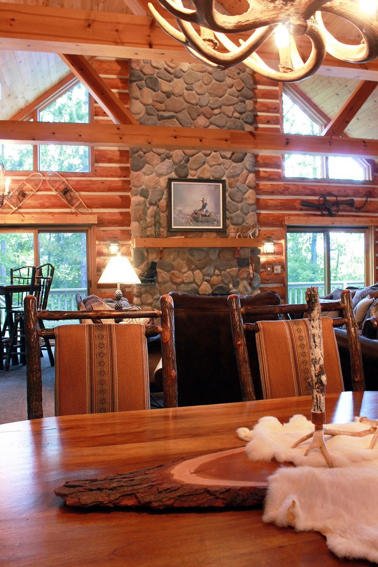 This rustic log home/cabin dining room and living room are ...
