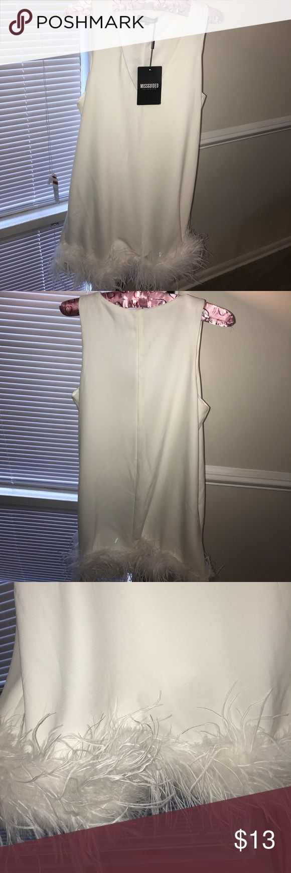 Miss Guides Dress w/Feathers Cream Cocktail Dress with white feathers at the bottom! Slip attached. Suppose to be loose fitting! More of a mini dress, feathers stop above your knee. Size US 8/EU 40/ UK 12.  95% Polyester, 5% Elastane. Missguided Dresses Mini