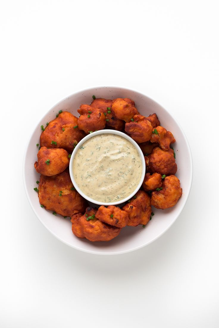 Buffalo Cauliflower Wings (Gluten-Free) - These Buffalo cauliflower wings are baked, not fried and also gluten-free. They're so easy to make and a super healthy snack, appetizer or side.