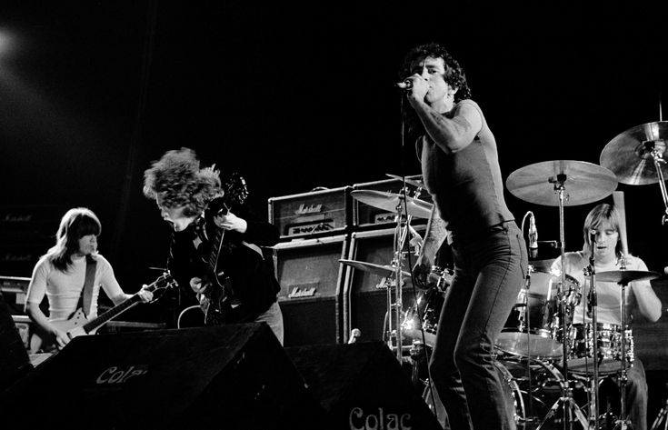 COPENHAGEN, DENMARK - APRIL: Malcolm Young, Angus Young, Bon Scott (vocals) Phil Rudd (drums) from AC/DC perform live on stage in Copenhagen, Denmark in April 1977 (Photo by Jorgen Angel/Redferns) via @AOL_Lifestyle Read more: http://www.aol.com/article/2016/07/11/cliff-williams-leaving-ac-dc/21429785/?a_dgi=aolshare_pinterest#fullscreen