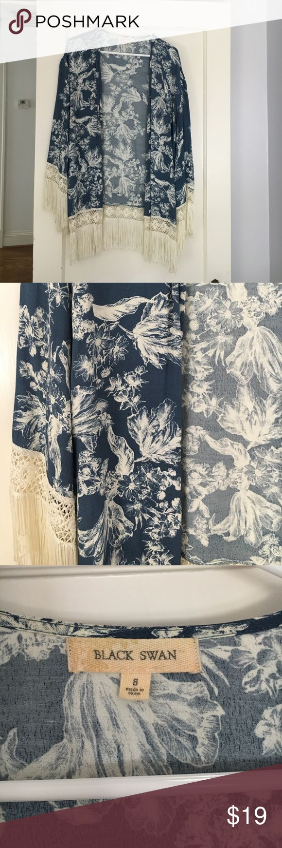 Blue and White Kimono Kimono from Black Swan, beautiful floral print. Prettt long- hits mid-thigh ish. Loose fit so it could fit a small medium or large. My closet is buy two get one! See the listing which I have posted to explain this. In addition I do bundle discounts 💃🏻 Black Swan Tops