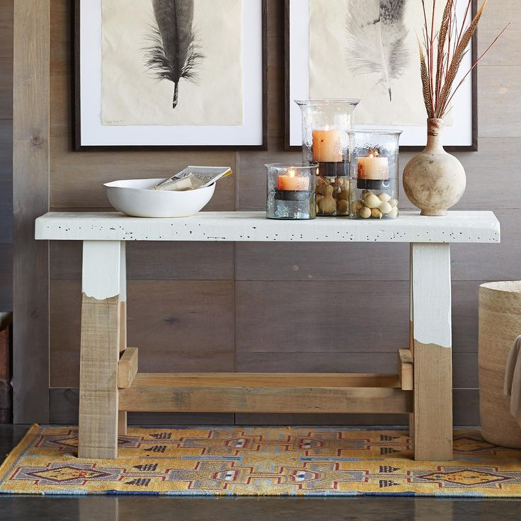 MORLEY SAWHORSE CONSOLE--This sturdy and stylish reclaimed wood console table is crafted from pine joists salvaged from the milking parlors of Midwest dairy farms. The historical beauty of the wood shows itself in its imperfections, ridges and nicks