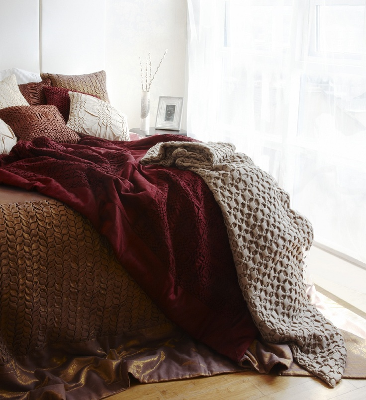 Nitin Goyal's lovely collection of cushions and bed covers are shown here in this casual shot. http://www.pomegranate-living.com/brands-nitin-goyal.irc