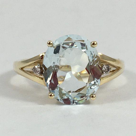 Hey, j'ai trouvé ce super article sur Etsy, chez https://www.etsy.com/fr/listing/278850962/vintage-aigue-marine-et-diamants-bague