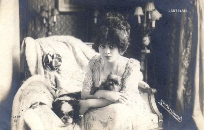 """Geneviève Lantelme holding a Griffon. Lovely addition to our Vintage Griffonia collection. Geneviève """"Ginette"""" Lantelme (born Mathilde Fossey; 1887-1911) was a French actress, socialite and courtesan, best known as the mistress of Alfred Edwards,..."""