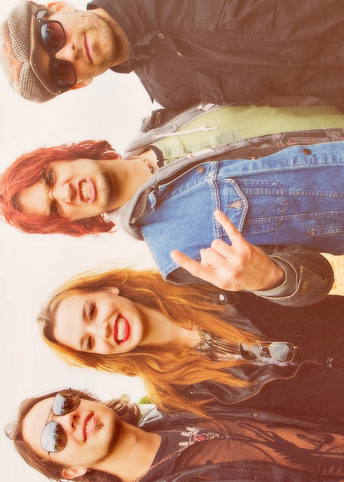 Halestorm! :D  Left to right, Joe Hottinger (guitar) Lzzy Hale (lead singer) Arejay Hale (drums) and Josh Smith (bass)