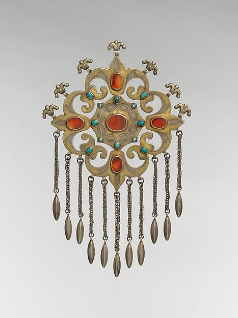 Floral Pectoral Ornament Object Name: Pectoral ornament Date: late 19th–early 20th century Geography: Central Asia or Iran Culture: Islamic Medium: Silver, fire-gilded and chased, with ram's-head upper terminals, openwork, wire chains, embossed pendants, table-cut carnelians, and turquoise beads