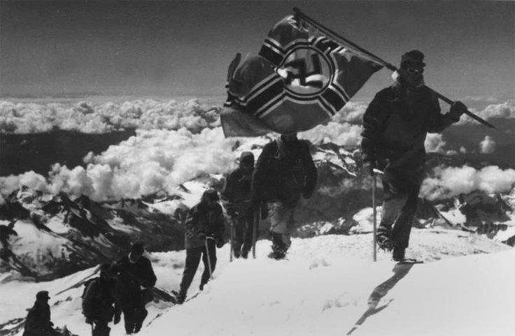 "August 21st, 1942, in the midst of Operation Barbarossa, 23 daring German Gebirgsjäger mountain troops reach the summit of Europe's tallest mountain, Mt. Elbrus, located in the Caucasus region of southern Russia. The troops then plant the Reich's war flag at the peak to mark their achievement. Hitler soon got word of this feat, but instead of joy, he was furious, exclaiming ""those crazy mountain climbers! They belong before a court-martial! Pursuing their idiotic hobbies in the midst of a…"