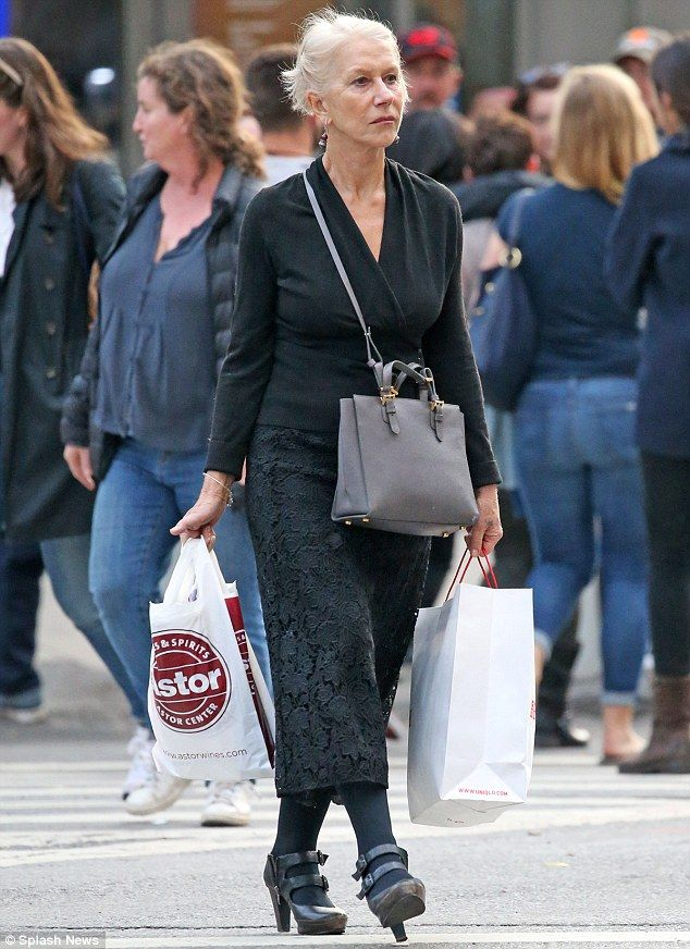 Good spirits: Helen carried two shopping bags including one from a wine and spirits store