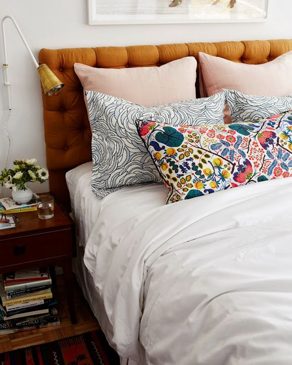 i love the light and clean white beading with colour pillows and cushions - plus that headboard!