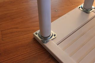This weekend I was able to paint my shutter table... I'm loving it in a glossy white. And here's how the legs are attached...nice and stur...