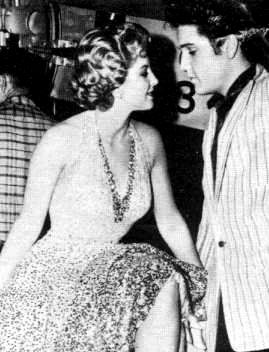 Elvis between take on the movie set Jailhouse rock may/june 1957. Here with one of his co-star. In that movie Elvis used one of his personnal jacket Elvis start used that jacket in june 1956