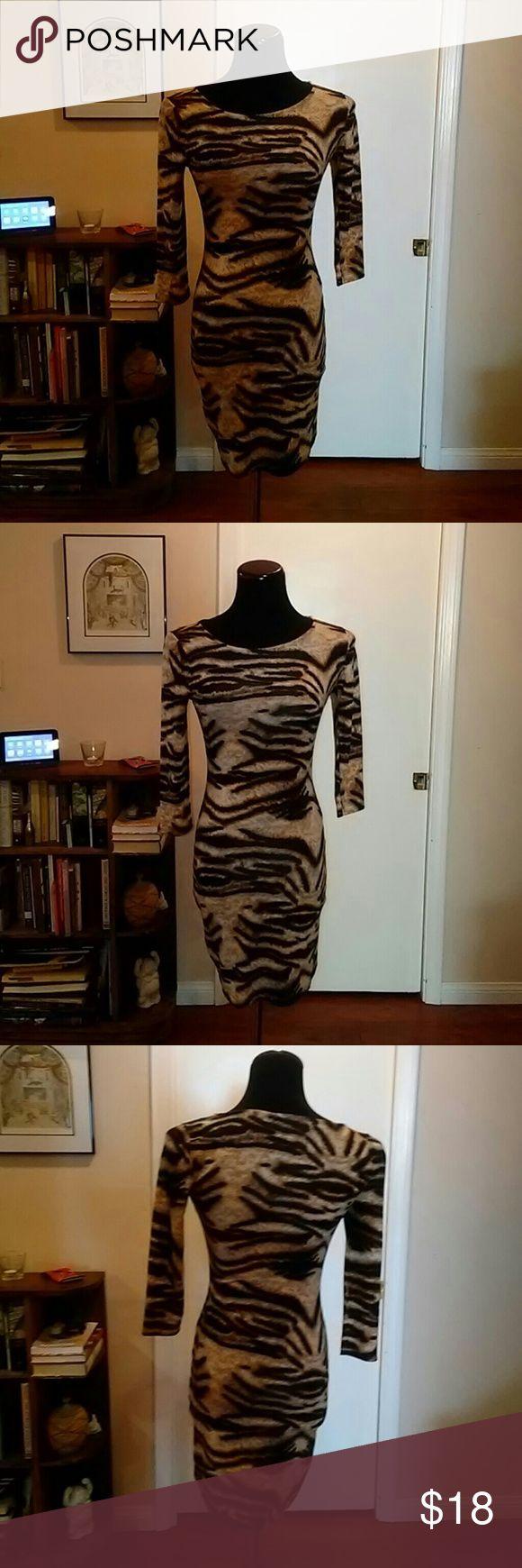 Animal Print Mini Dress Sexy Animal Print dress with scoop neck. Forever 21 Dresses Mini