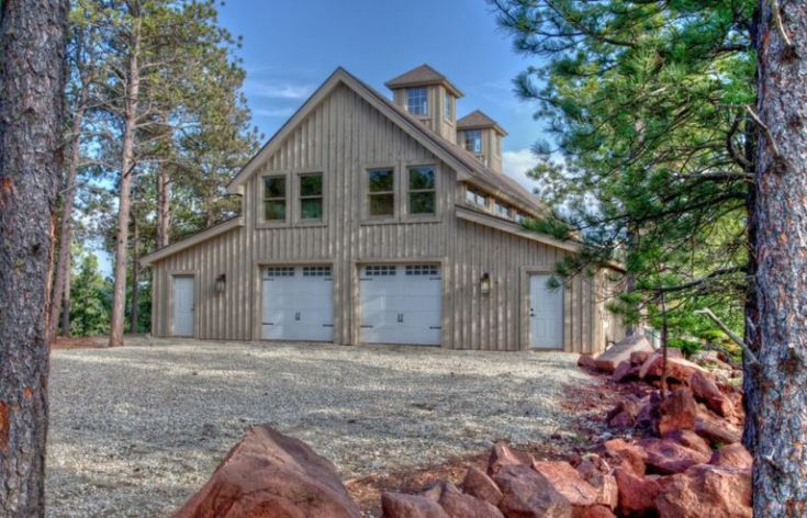 Rustic barndominium with wood siding