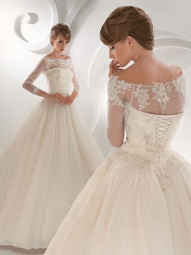 Marina Danilova!  delicate wedding dress! love the 3/4 sleeve if I were to go full length this would be it. Gorgeous.