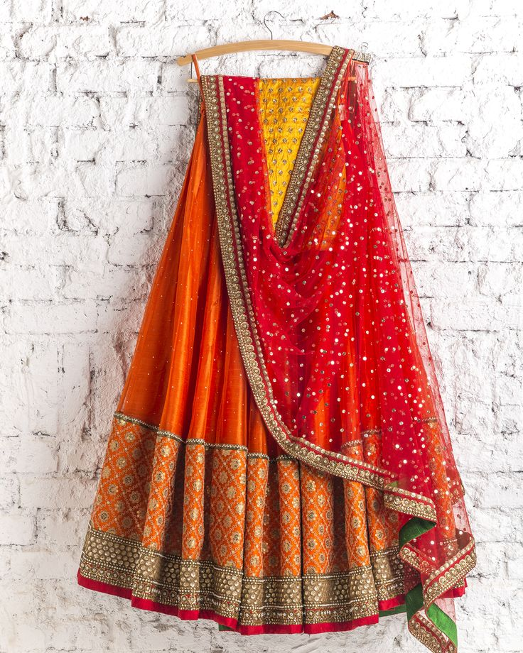 Lehengas by SwatiManish : Burnt orange lehenga with kumkum red dupatta