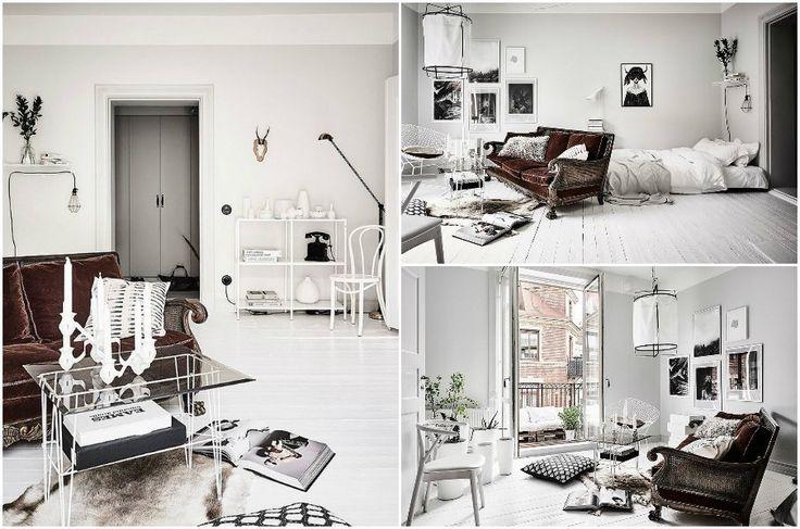 Винтажный диван служит фокусной точкой в минималистичном интерьере в стиле сканди