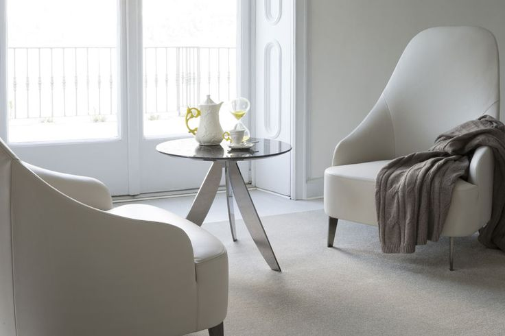 The Vanessa armchair is customizable in every detail and comes available with a chrome swivel base.