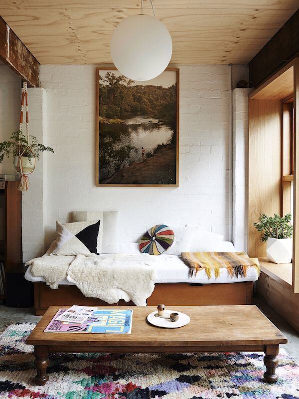 Melbourne home of Alex Kennedy. Interior design by Sarah Trotter of Hearth Studio. Beneath The Sun patchwork cushion and stripes plate, Connor OBrien print. From The Design Files.